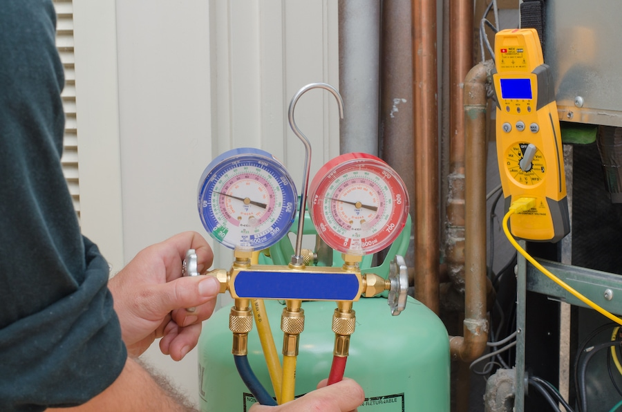 Charging a residential heat pump system with refrigerant.