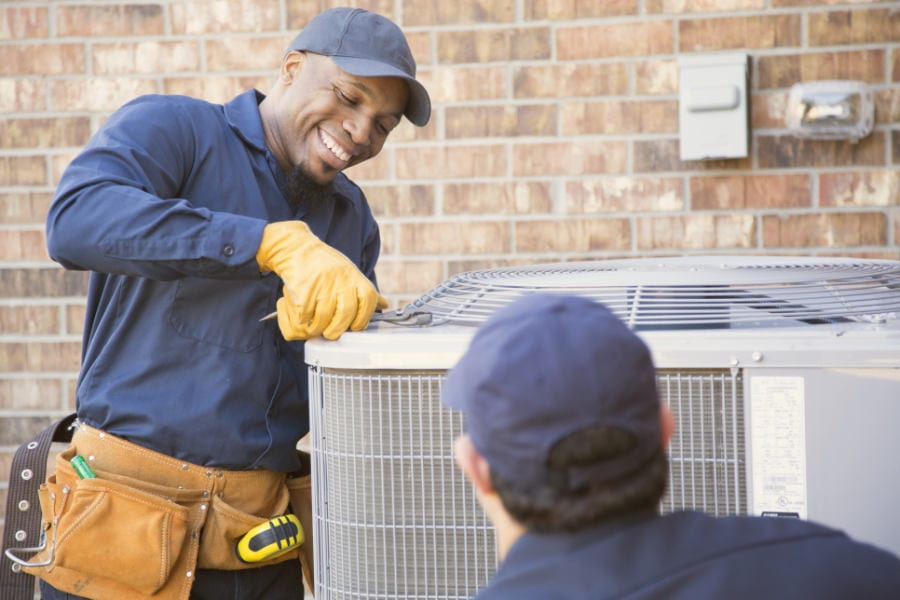 Air conditioning technician outside in Austin, TX.