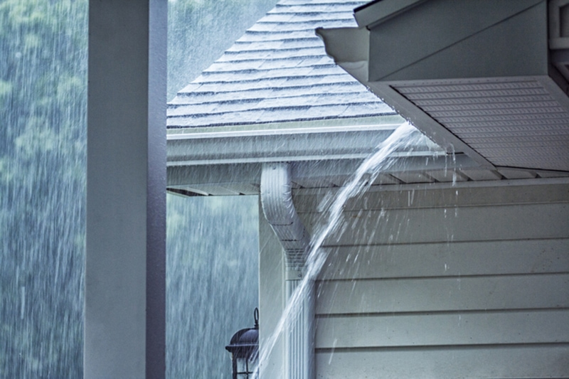 Drenching Rain Storm Water Overflowing Roof Gutter