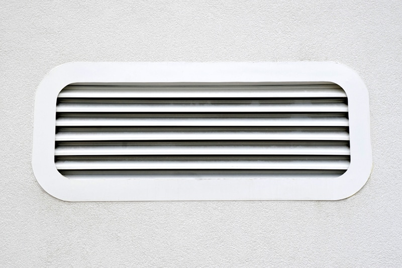 White air vent on wall